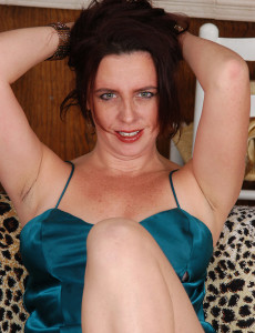 Brown Haired  Mom in Sheer Blue Thong Poses for Us in Here