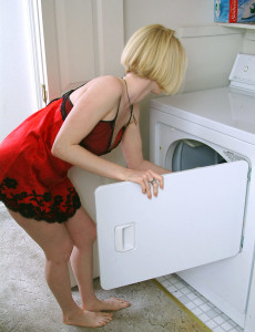 Blond Cougar Gets Hot Doing Laundry So She Disrobes Nude