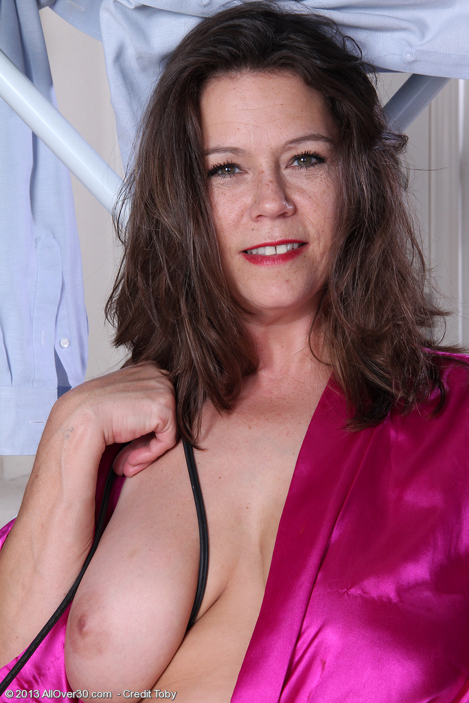 43 year old and big breasted milf christy takes a break from ironing