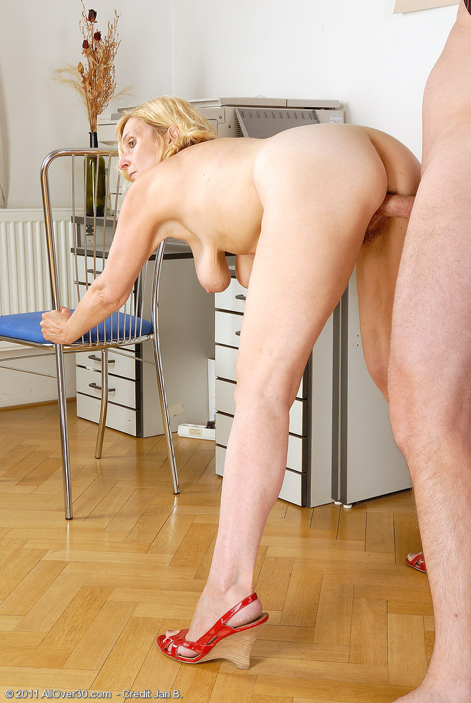Blond slim mature takes care of slim blck young man 9