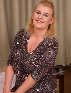 Elegant and 40 Year Old Kira T  Takes off Ans Preads Her Ample Gams Here