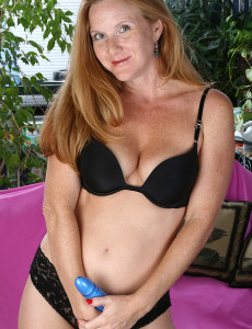 Slim  Older Babe Redhead  Takes off and Enjoys Her Plastic Pal in Here