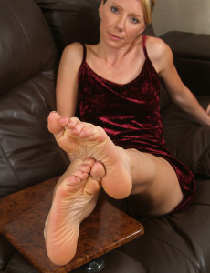 34 Year Old  Blond Haired Olga from  Milfs30 Displays Long Gams and  Hot Soles