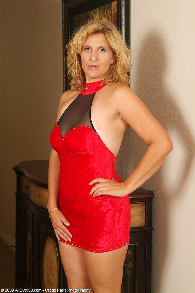 45 year old tara from milfs30 poses in and out of her red Sexy 30