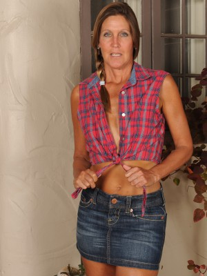 Thin 50 Year Old La Valkenberg Glides out of Her Short Jeans Miniskirt