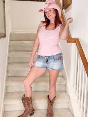 Redheaded  Cougar Shelly Jones  Takes off off Her Jeans Cut-offs on the Stairs