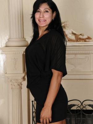 Exotic 43 Year Old Estrella Jane Slides from the Woman Ebony Elegant Dress