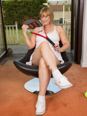 Milf Comes Back Home from Tennis and Does a Stylish Strip Tease