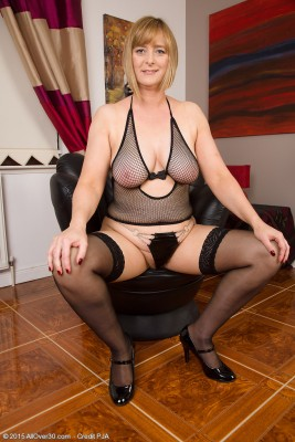 Huge-titted April Wraps Her  Hot Mummy Types in Fishnet