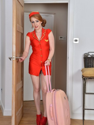 Magnificent Redhead Stewardess Tia Jones Gets Residence and Flashes Her Hairy Hole