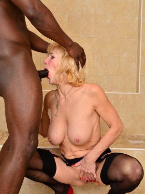 Blond milf enjoys her two black bulls