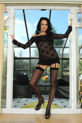 Leggy Milf Julie D is Supposed to Be Removing Her Thigh Highs and Taunts Us