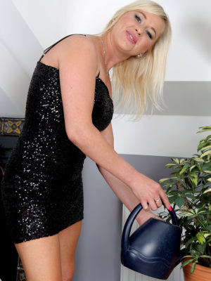 Beatiful  Blond Evelina Jones Waters Her Flowers and Taunts